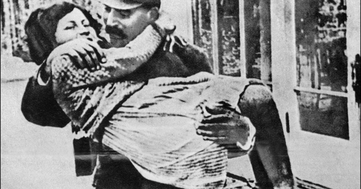 Undated and unlocated picture of Joseph Stalin holding in his arms his daughter Svetlana.</p>