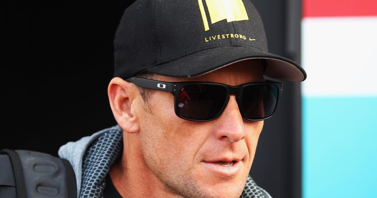 Seven-time Tour de France winner Lance Armstrong attends the Paris Roubaix cycling race on April 8, 2012, in Paris.</p>