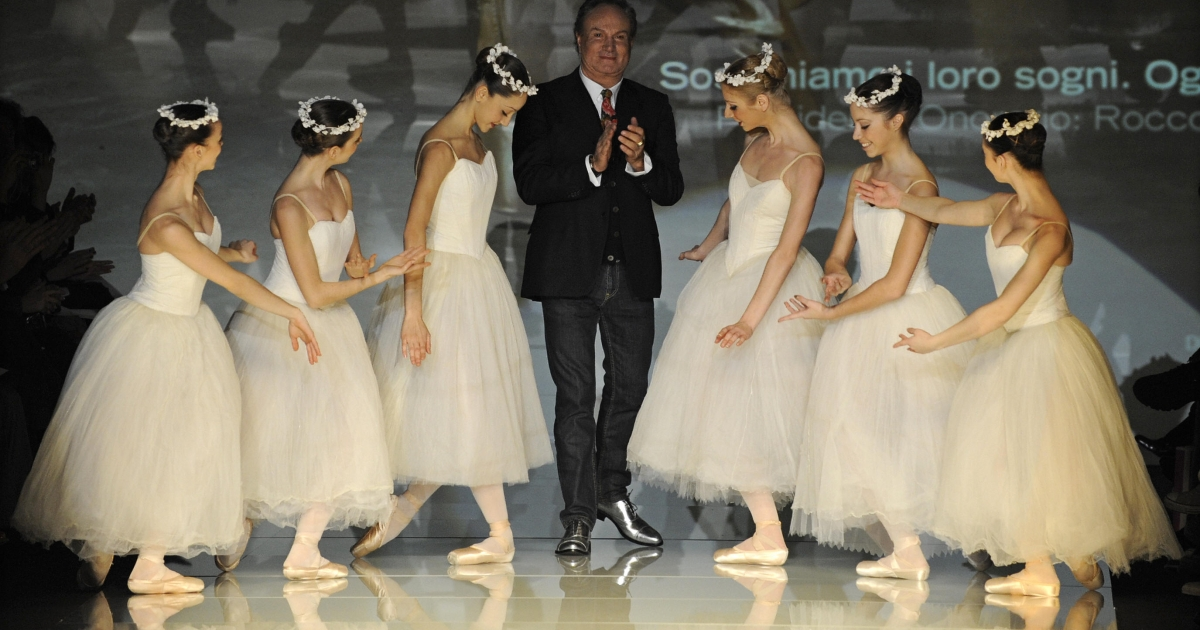 Italian fashion designer Rocco Barocco applauds ballet dancers at a showing of the Roccobarocco Fall/Winter 2009-2010 ready-to-wear collection during Women's fashion week in Milan in 2009.</p>