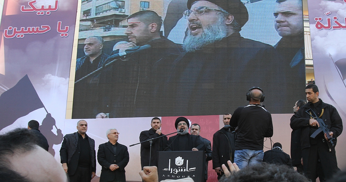 Lebanon's Hezbollah chief Hassan Nasrallah makes his first public appearance since 2008 before a frenzied crowd in the southern suburbs of Beirut on December 6, 2011.  Marking the Shiite commemoration of Ashura, Nasrallah spoke to the crowd of thousands assembled in his stronghold for only a few minutes and vowed to arm his fighters more heavily than ever.</p>