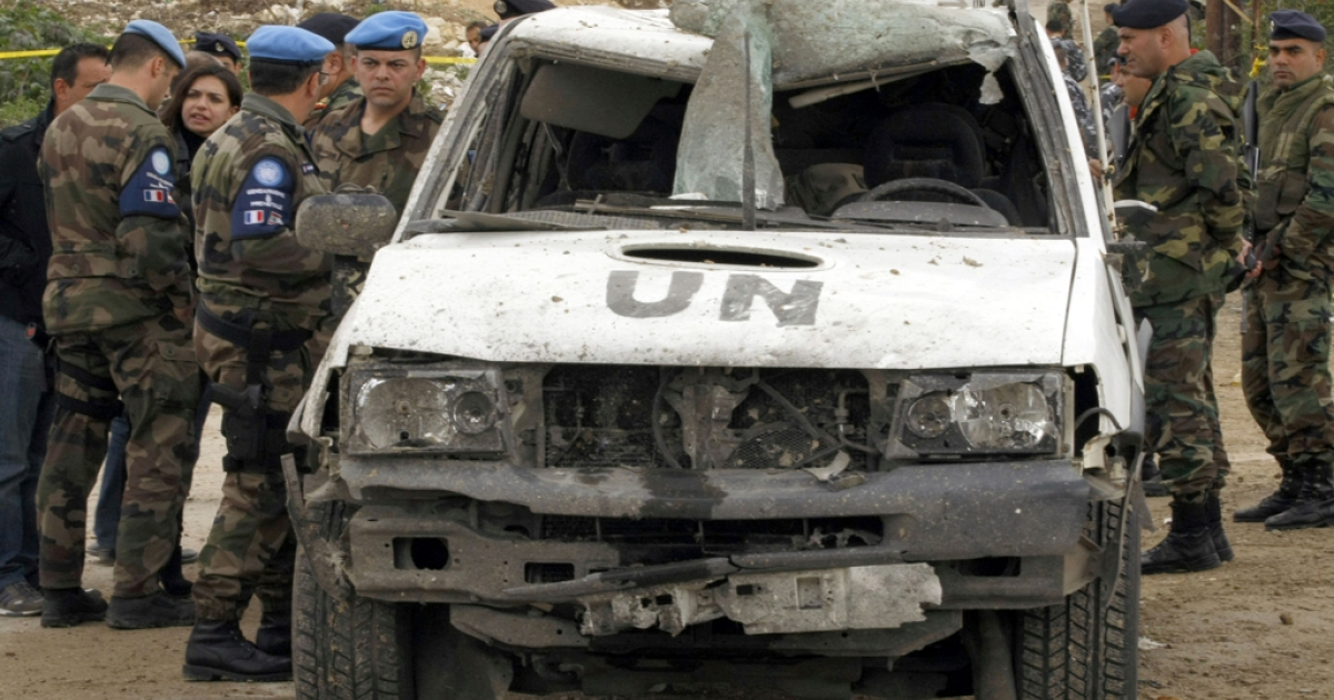 Peacekeeping soldiers with the United Nations Interim Forces in Lebanon (UNIFIL) inspect one of their damaged vehicle at the scene where a powerful bomb struck a UN peacekeeping patrol in the Lebanese coastal town of Tyre on December 9, 2011. UN chief, Ban-ki Moon, will visit Lebanon on Friday.</p>