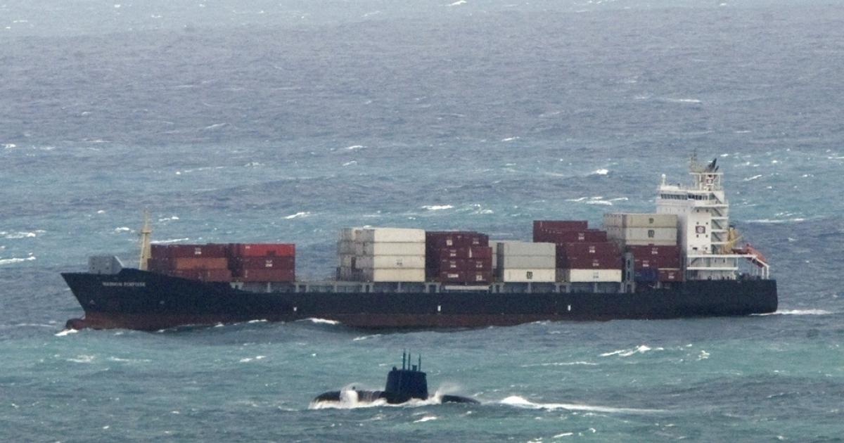 An Israeli submarine sails off the Mediterranean coastal city of Haifa on April 12, 2011.</p>