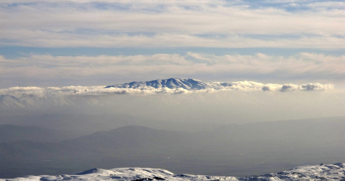 The snow-covered Mount Hermon (Jabal al-Sheikh) which sits on the border between Lebanon, Syria and Israel is seen in the distance from the Kfardebian-Faraya ski resort, northeast of the Lebanese capital Beirut, on January 10, 2012.</p>