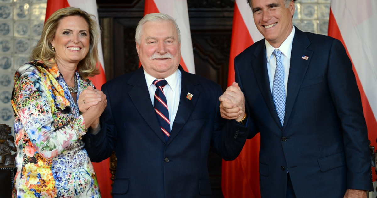 Republican presidential candidate and former Governor of Massachusetts Mitt Romney (R) and his wife Ann (L) hold the hands of former Polish President and Nobel Peace Prize winner Lech Walesa (C), during a meeting at Artus Court, in Gdansk, on 30, 2012.</p>