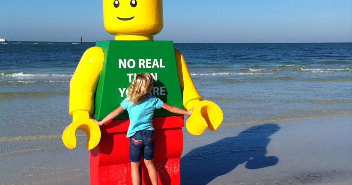 Beachgoers snapped photos and shot videos of the larger-than-life Lego man that washed up on Sarasota's Siesta Key beach.</p>