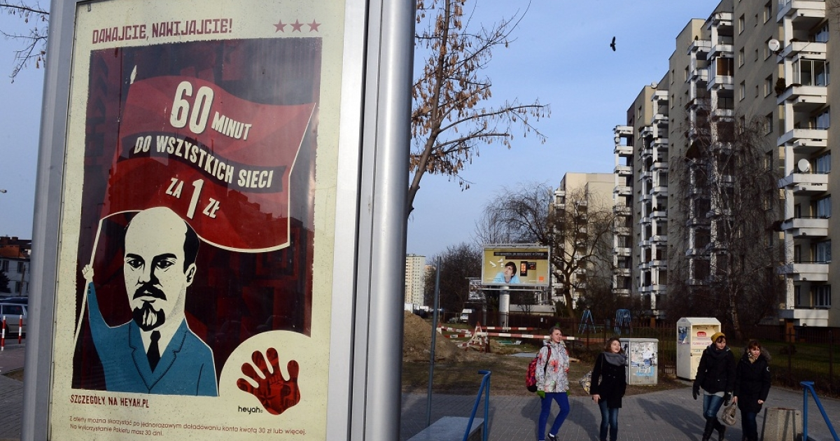 An advertising poster by one of Polish mobile operators featuring a caricature of former Soviet leader Vladimir Lenin is pictured in Warsaw on January 8, 2013.</p>