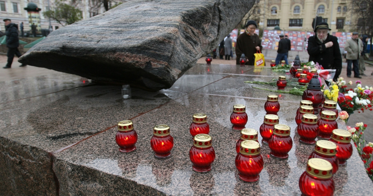 People place candles near the Solovetsky stone in front of the FSB, formerly KGB, headquarters in Moscow on October 29, 2009.</p>