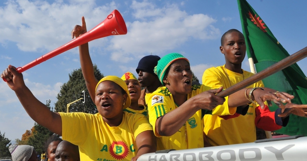 Supporters of Thomas Thabane, leader of the All Basotho Convention (ABC) party, celebrate in Maseru. Thabane is expected to become the tiny country's new prime minister. Voting took place smoothly across the kingdom where most people live as farmers in villages separated by towering mountain ranges, which many crossed by foot to reach their polling stations.</p>