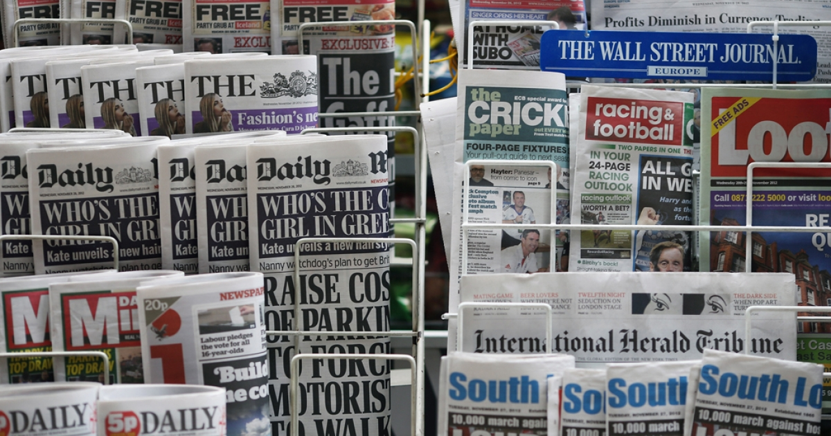 Newspapers are displayed on a stand outside a newsagent on November 28, 2012 in London, England. The findings of the Leveson Inquiry which focused on the culture, practices and ethics of the press, is due to be published tomorrow by Lord Justice Leveson after an 18 month inquiry.</p>