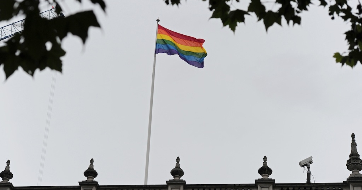 The rainbow flag, symbolising gay pride, flies above the Cabinet Office in central London, on July 6, 2012. The British government on Friday hoisted the rainbow flag symbolising gay pride over one of its ministries for the first time. Deputy Prime Minister Nick Clegg requested the flag be flown on Whitehall, the central London street that houses several ministries, ahead of the World Pride parade celebrating gay rights in the British capital on Saturday.</p>