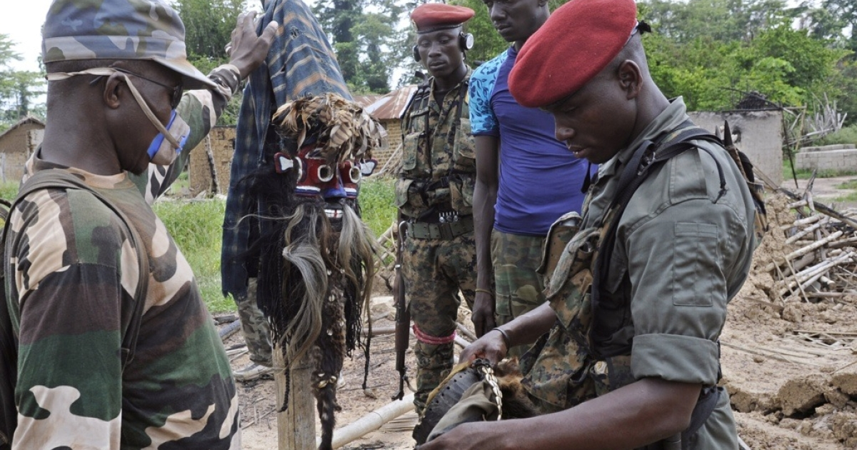 There are worried that Liberia's elections could erode the country's security, as the elections in neighboring Ivory Coast took that country to the brink of civil war. Here Ivory Coast militia look at african masks in a burned out village at Liberia's border with Ivory Coast on April 21, 2011.</p>