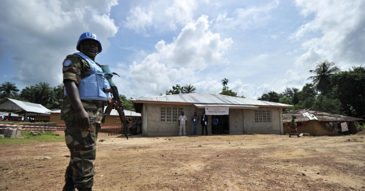 A UN peacekeeper patrols as Liberian incumbent President Ellen Johnson-Sirleaf casts her ballot in her hometown on Nov. 8, 2011.  Early voting was slow in the tense capital following Monday's violence, in marked contrast to long lines that greeted the opening of the polls in last month's first round.</p>