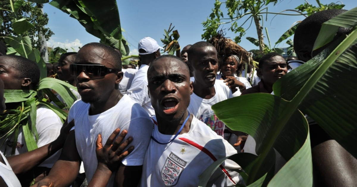 Liberian opposition Congress for Democratic Change (CDC) party supporters rally in Monrovia on Nov. 7, 2011. At least one person was killed during the rally that turned violent on the eve of the presidential election run-off.</p>