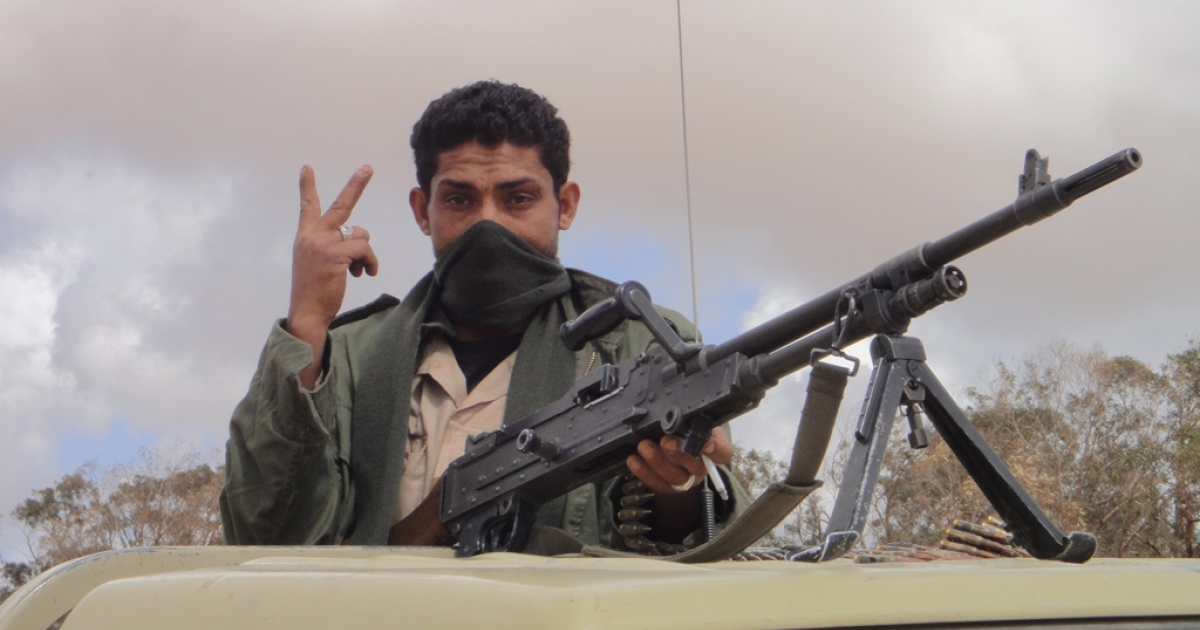 A rebel soldier flashes the V for victory as he speeds out to the front on Sunday.</p>
