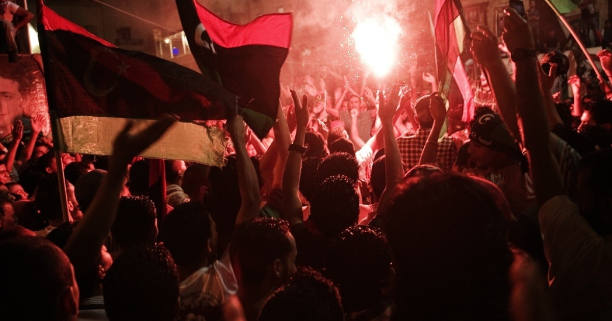 Libyans celebrate the seizure of Muammar Gaddafi's compound on Aug. 24, 2011, in the eastern city of Benghazi.</p>