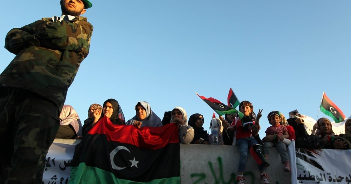 Libyan women and children wave the new government's flags during a celebration in Tripoli's Martyrs Square on Oct. 13, 2011.</p>