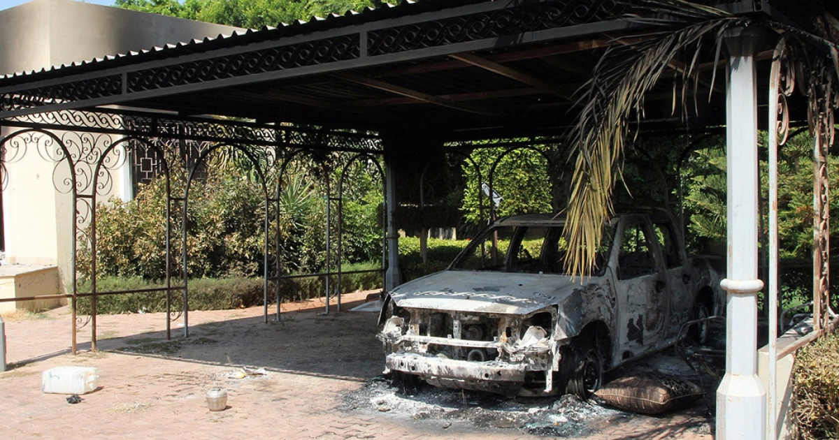 The wreckage of a car sits inside the US Embassy compound on September 12, 2012 in Benghazi, Libya, following an overnight attack on the building. The US ambassador to Libya and three of his colleagues were killed in an attack on the US consulate in the eastern Libyan city by Islamists outraged over an amateur American-made Internet video mocking Islam, less than six months after being appointed to his post.</p>