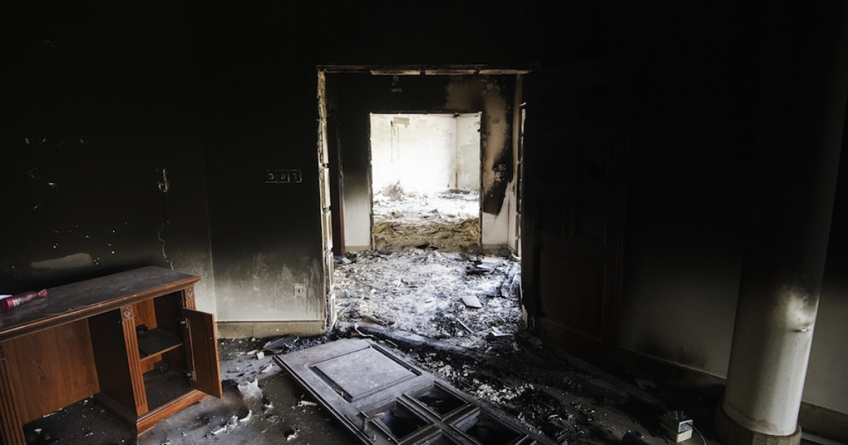 A picture shows damage inside the burnt US consulate building in Benghazi on September 13, 2012, following an attack on the building late on September 11 in which the US ambassador to Libya and three other US nationals were killed. Libya said it has made arrests and opened a probe into the attack, amid speculation that Al Qaeda rather than a frenzied mob was to blame.</p>