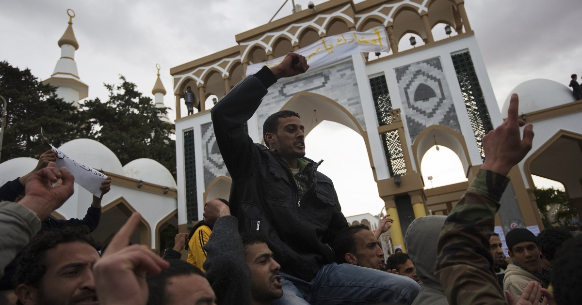 Libyans shout anti-Gaddafi slogans during a demonstration in the eastern Libyan town of Derna, between Tobruk and Benghazi, on Feb. 23, 2011 amid reports that Muamer Gaddafi's regime has lost vast swathes of Libya's east to an insurrection.</p>