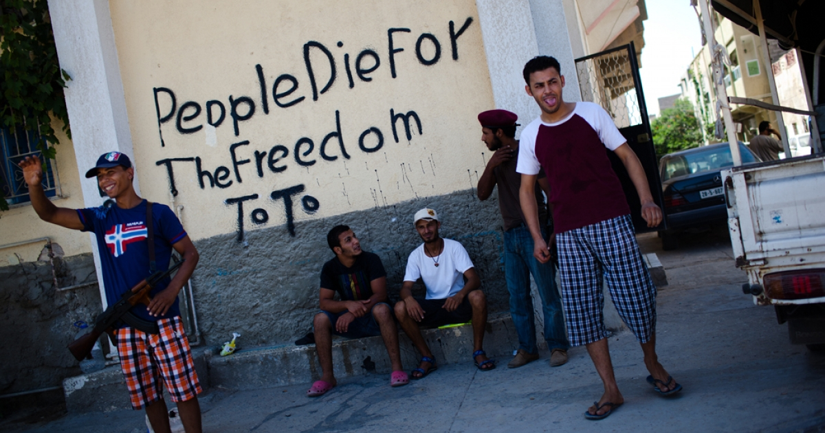 Slogans against Muammar Gaddafi at the 32nd Brigade military base on August 29, 2011 in Tripoli, Libya.</p>