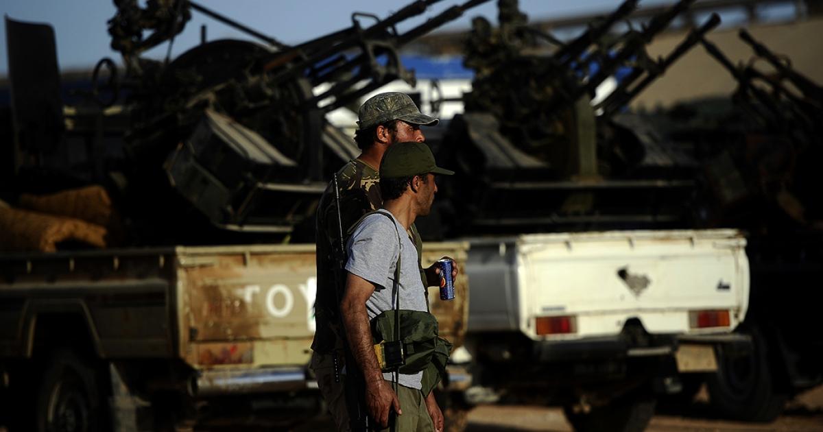 Libyan rebels guard their advanced military position near Al-Sadaadi on the road between Misrata and Sirte on August 31, 2011.</p>