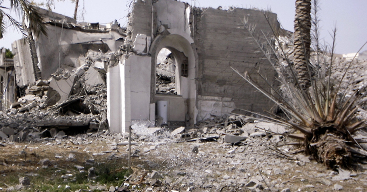 A picture shows a destroyed building at the Bab Al-Aziziya district where veteran leader Moamer Kadhafi has his base, in Tripoli on June 7, 2011 as NATO warplanes pounded the Libyan capital.</p>