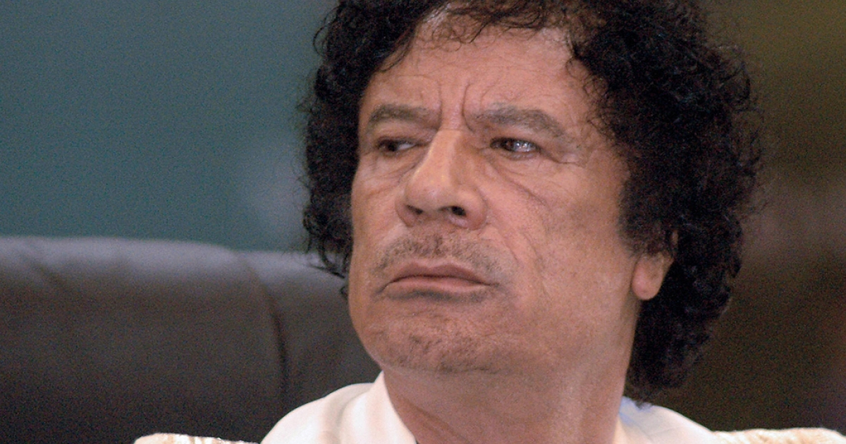 Muammar Gaddafi looks on during a celebration to mark the 30th anniversary of the establishment of Libya's Jamahiriyah, or State of the Masses, on March 2, 2007 in Sebha, 600 miles south of Tripoli.</p>