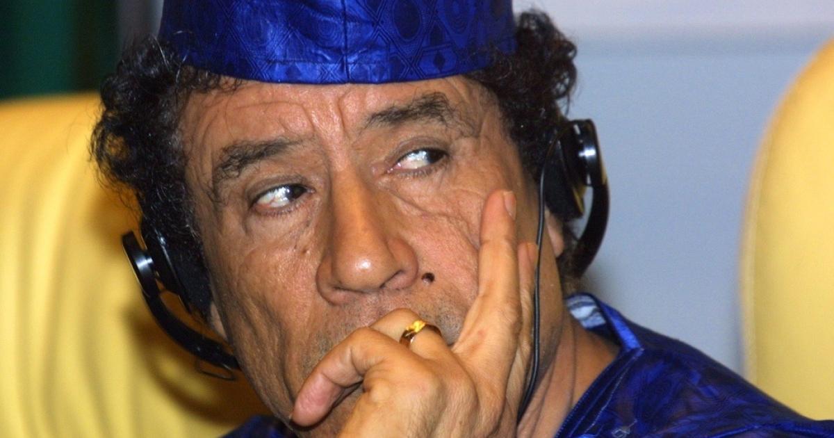 Col. Muammar Gaddafi at an international conference in 2001.</p>