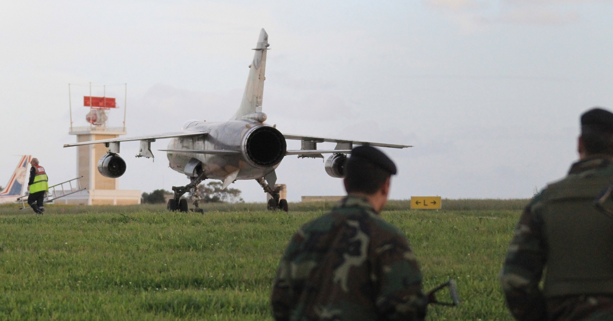 A Libyan air force F1 mirage sits on the tarmac of Malta airport after landing on Feb. 21, 2011. Two Libyan fighter jets and two civilian helicopters carrying seven people who told immigration police they were French landed in Malta on Monday, Maltese military sources told Agence France-Presse.</p>