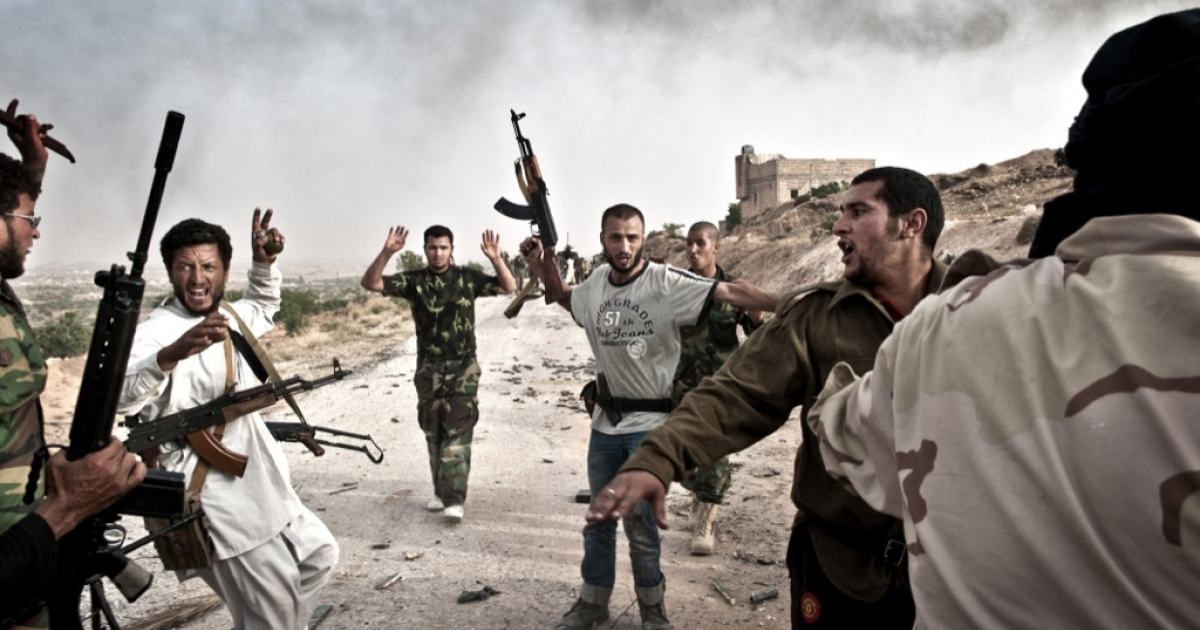 Libyan rebels round-up soldiers loyal to Col. Muammar Kadhafi following their capture in Libya's western mountain region of Qalaa on June 7, 2011.</p>