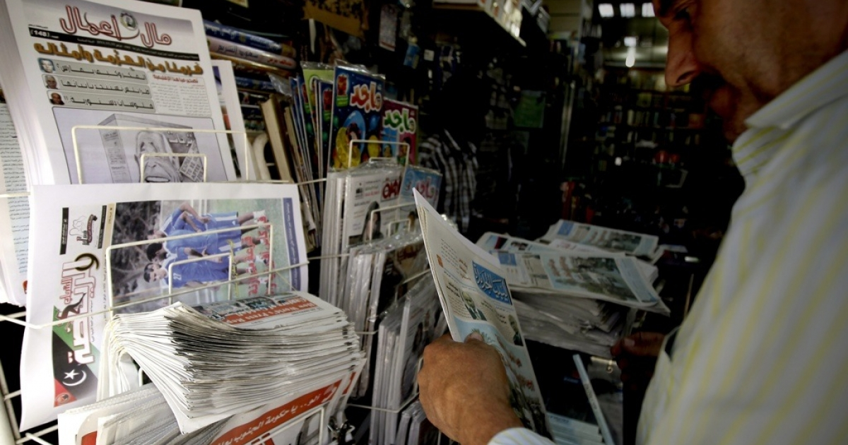A Libyan man buys a newspaper from a newstand in Tripoli on Nov. 15, 2011. Media outlets are witnessing a huge expansion in Libya after the country's revolution.</p>