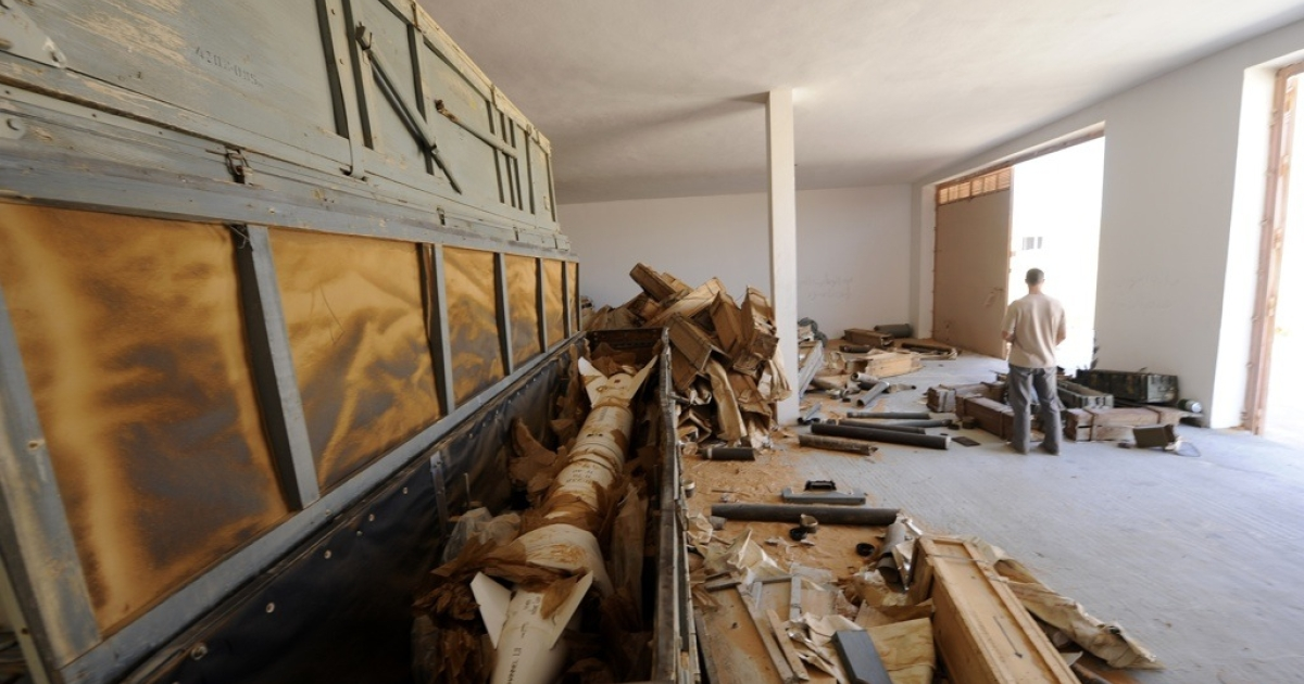 A missile in a wooden crate is seen in an ammunition storage bunker some 100 kilometers south of Sirte, Libya on Oct. 26, 2011.</p>