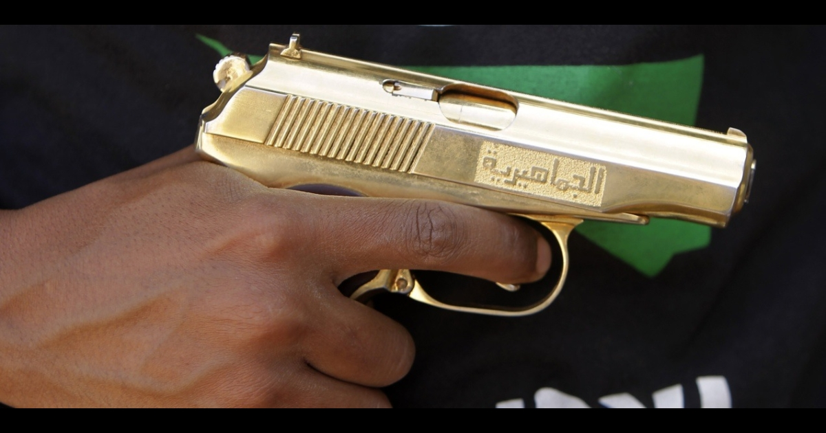 A man holds a golden gun that he says he found in the former compound of ousted leader Muammar Gaddafi. More than 20,000 criminal prisoners escaped during the revolution. And now police say they are all armed.</p>