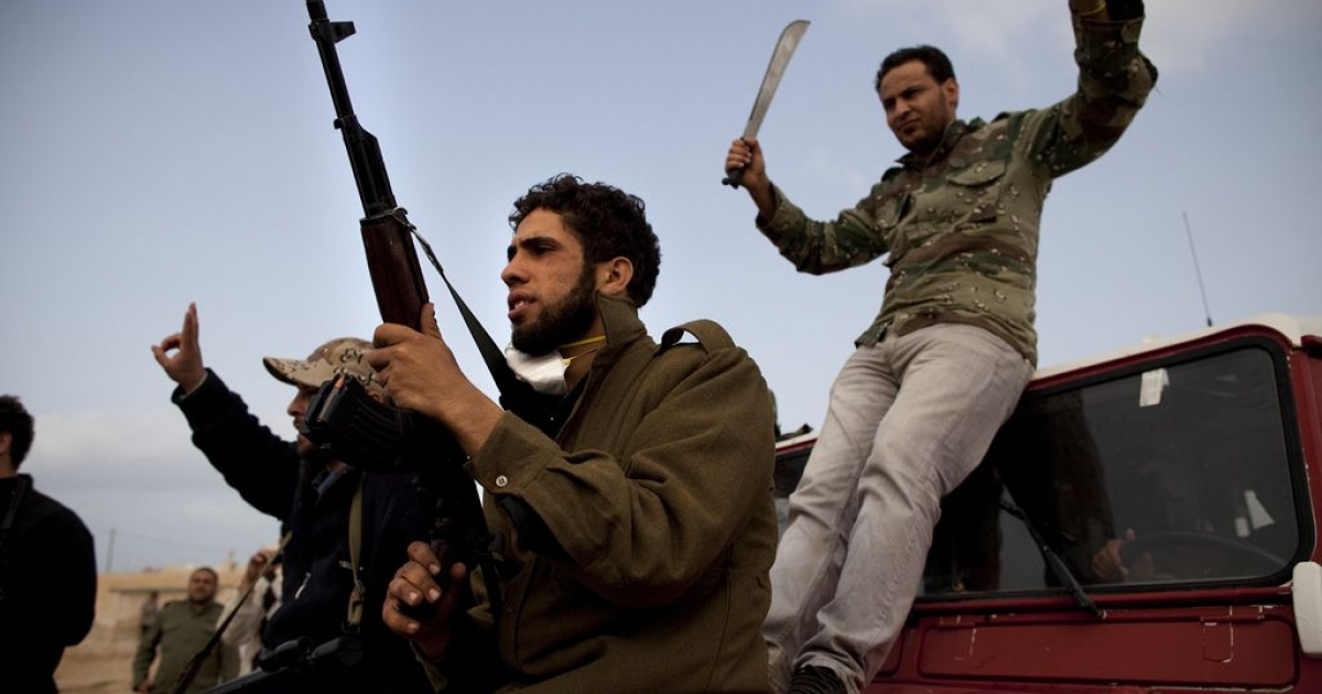 Rebel fighters push onward in the strategic oil town of Ras Lanuf in Libya on March 5, 2011.</p>