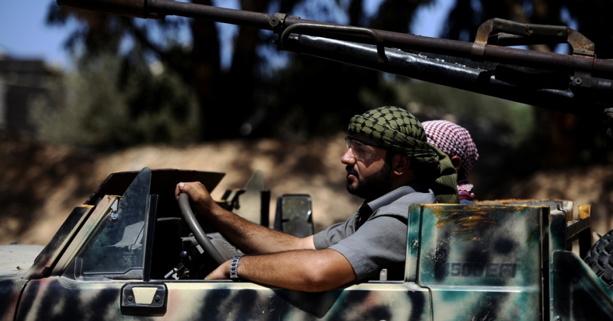 Libyan rebels drive on the road between Misrata and Sirte. Rebel fighters from Misrata have been difficult to control in post-Gaddafi Libya.</p>