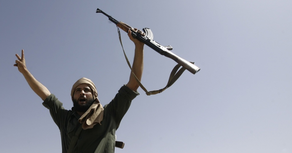 A Libyan rebel flashes the V-sign for victory on Sept. 25, 2011 outside of Bani Walid, Libya. New clashes in the former loyalist stronghold have sparked rumors that Gaddafi supporters are regrouping. GlobalPost traveled to the embattled city to find out.</p>