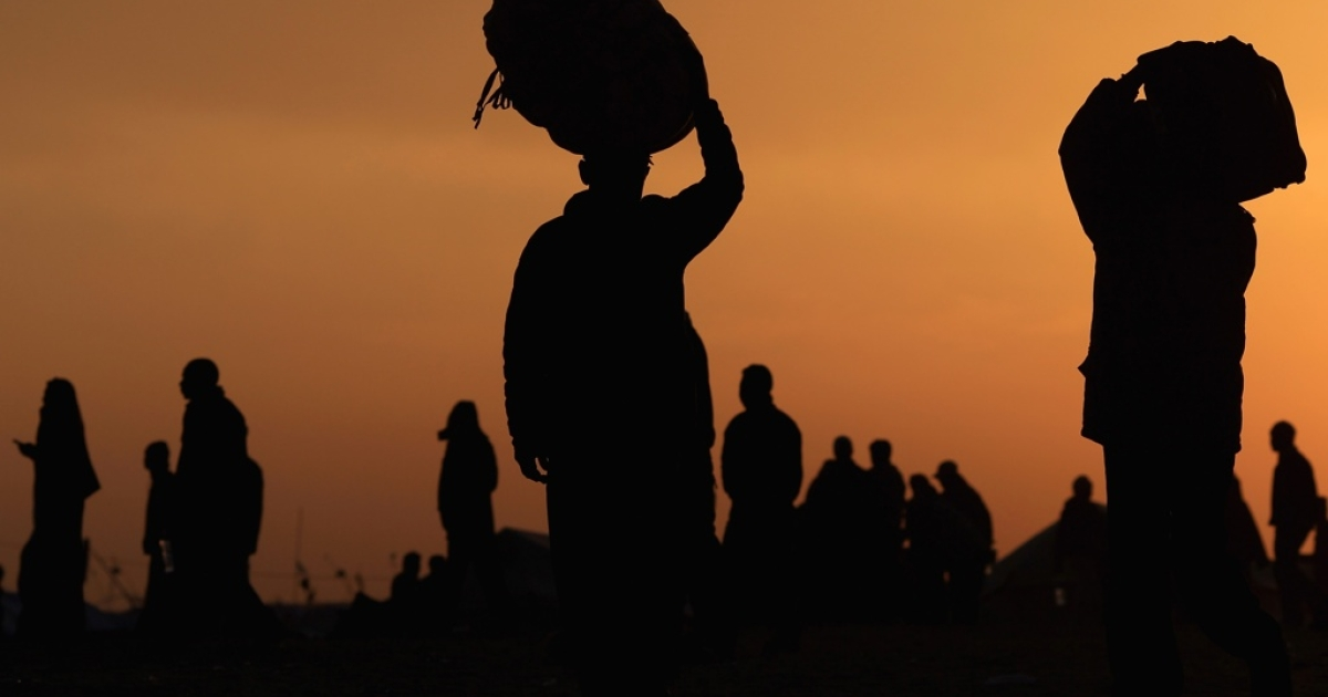 Libyan refugees flee violence in their country and seek a safe place at a United Nations displacement camp on March 11, 2011 in Ras Jdir, Tunisia. Men, women and children have descended on Tunisia, creating a humanitarian crisis in the country which itself has only recently toppled its former president in an uprising.</p>
