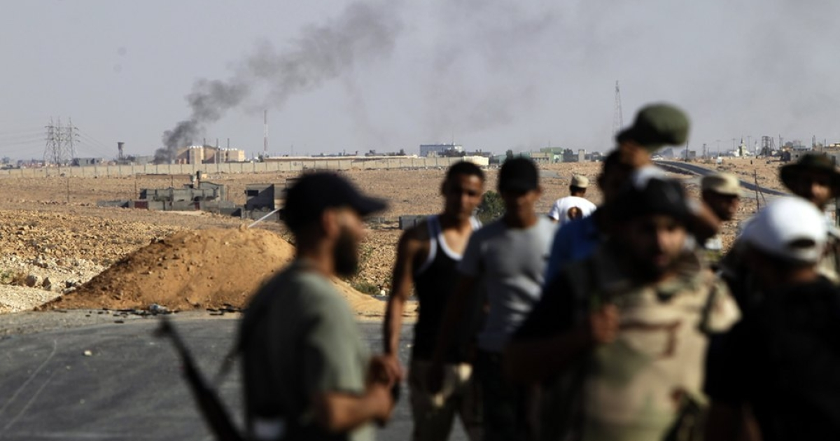 Libyan fighters supporting the National Transitional Council (NTC) at an outpost close to the fighting against loyalists of deposed leader Muammar Gaddafi in Bani Walid on September 17, 2011. Rebels also met fierce resistance from Gaddafi loyalists in Sirte.</p>
