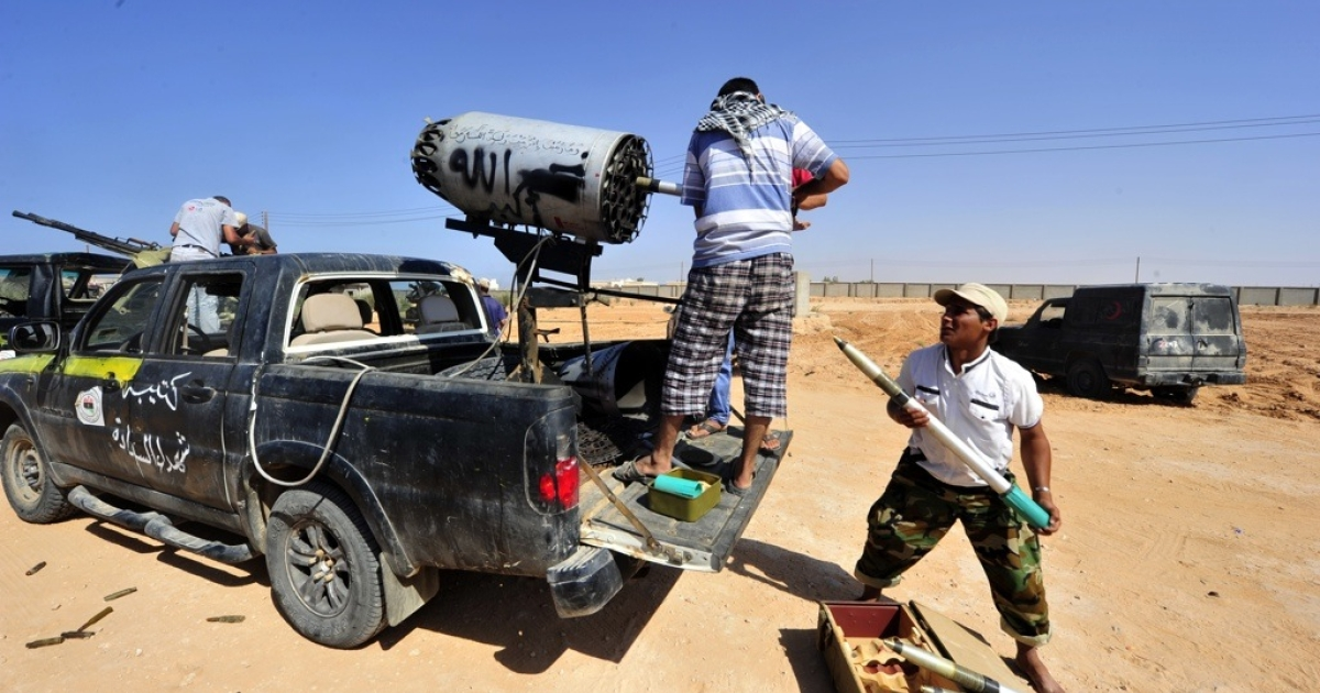 National Transitional Council fighters prepare for a fight in the city of Sirte on Sept. 24, 2011.</p>