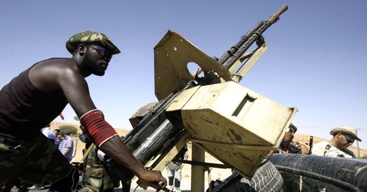 Libyan rebel forces said they advanced Thursday on the cities of Sirte and Bani Walid, two of the last strongholds of deposed leader Muammar Gaddafi. Here a Libyan rebel fighter handles a machine gun fixed on the top of a truck at the frontline with the city of Bani Walid on September 11, 2011.</p>