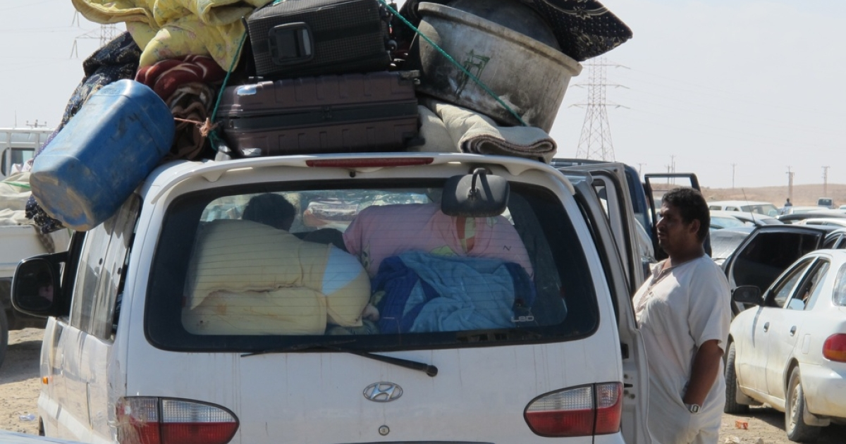 Residents of Sirte flee the besieged city with as many of their belongings as they can carry.</p>