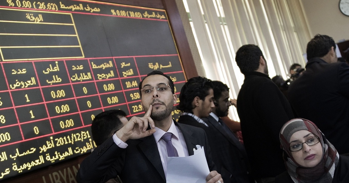 Brokers busy at work during the official reopening of the Libyan stock market in the capital Tripoli on March 15, 2012.</p>