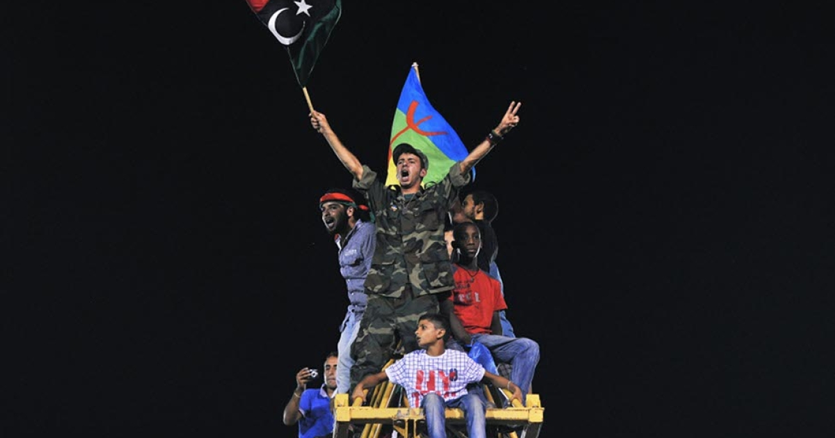 Libyans celebrate on top of a crane in Martyrs Square (formerly Green Square under Gaddafi) in Tripoli, Libya on August 30, 2011. Thousands of Libyans gathered in the square to celebrate the success of rebel fighters against Gaddafi's forces and the beginning of the Muslim festival Eid.</p>