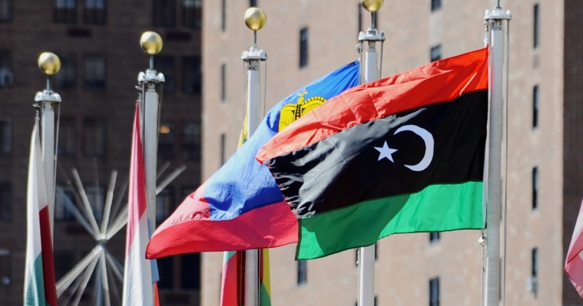 The flag of Libya's National Transitional Council flies outside United Nations headquarters September 19, 2011 in New York.</p>