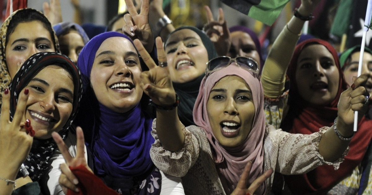 Libyan women celebrate at Martyrs Square in Tripoli on September 1, 2011.</p>