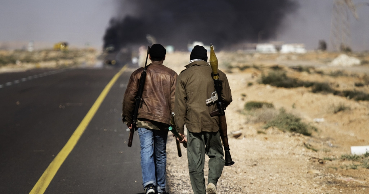 Smoke billows from the fighting in Sidra, 10 kilometres (six miles) west of Ras Lanuf, on March 10, 2011,</p>