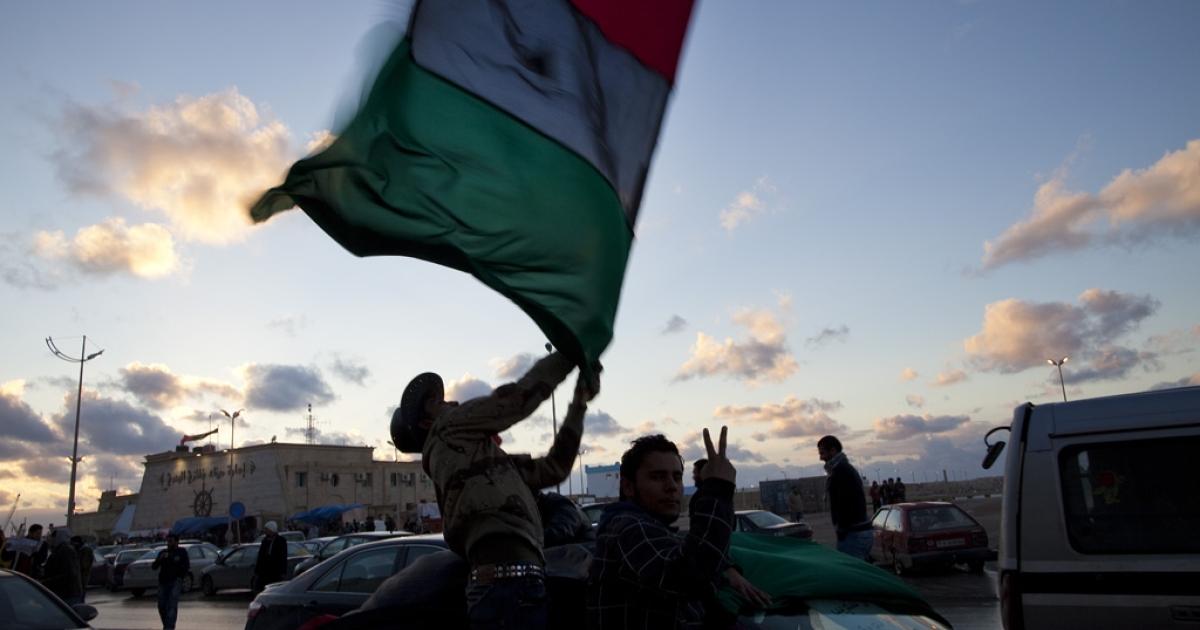 Opponents of Gaddafi drove through Benghazi waving the pre-Gaddafi flag.</p>
