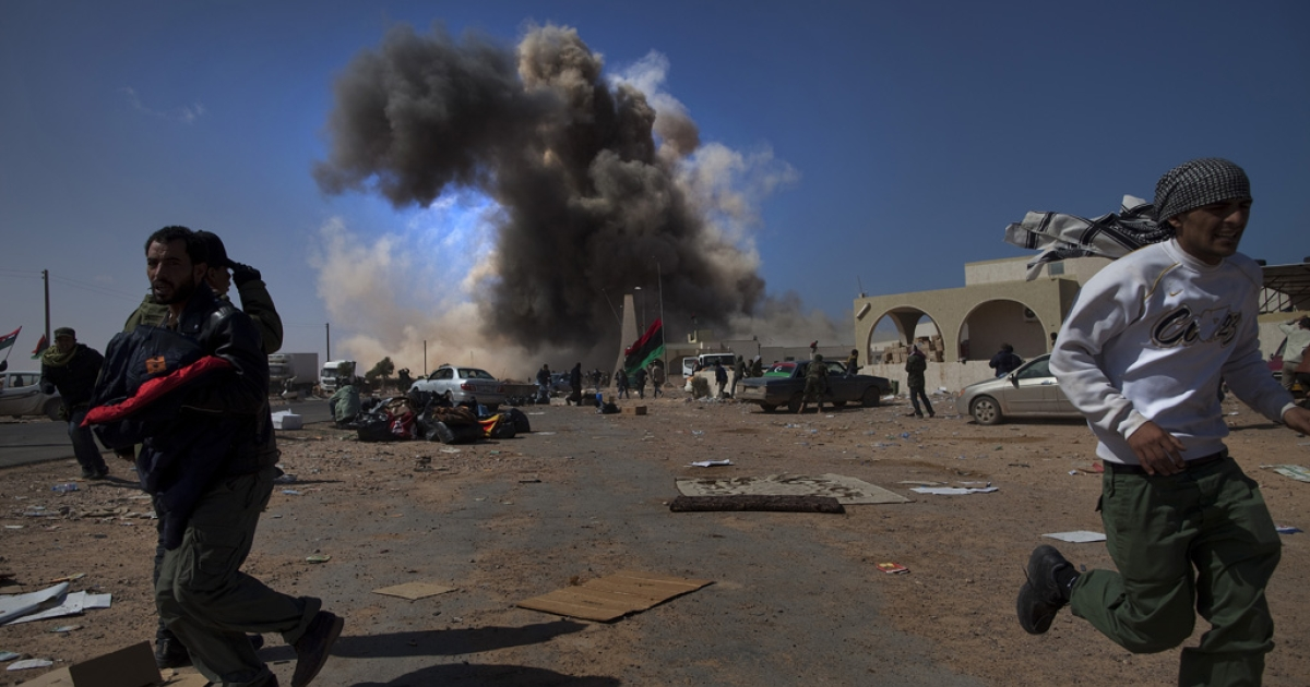 Government forces lead an air strike, hitting a checkpoint near the Ras Lanuf oil refinery, killing two rebels on March 11, 2011.</p>