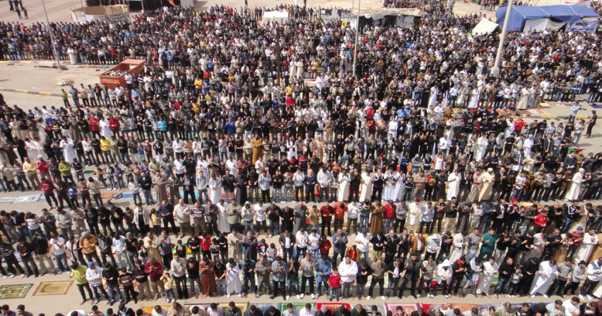 Residents of Benghazi pray on Friday as the U.S. allies vowed to strike back against Libyan leader Muammar Gaddafi.</p>