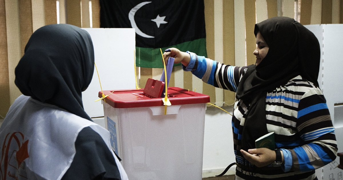 A Libyan woman casts her ballot at a polling station in Tripoli on July 7, 2012 as voters headed to the polls to elect Libya's General National Assembly.</p>